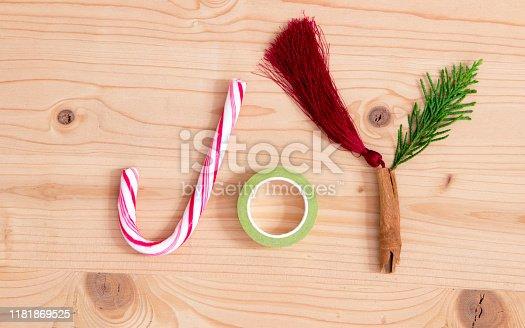 Christmas joy - word on wooden background