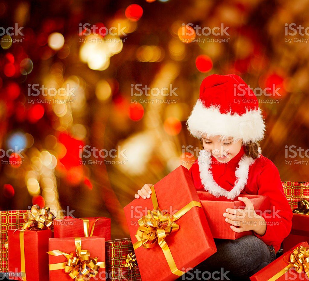 Christmas Kid Opening Present Gift Box Child In Santa Hat Stock ...