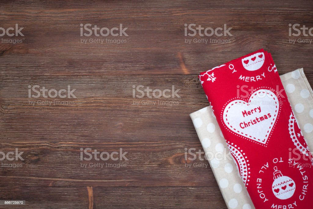 Christmas kitchen towels on the wooden background stock photo