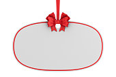 istock christmas label with red ribbon and bow on white background. Isolated 3D illustration 1271262121