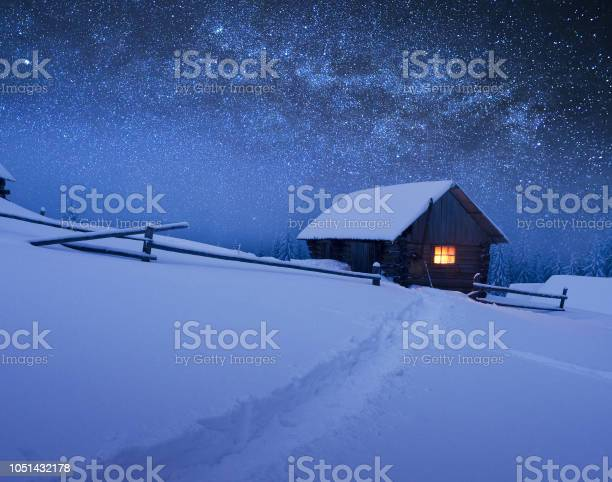 Photo of Christmas landscape with starry sky