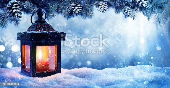 istock Christmas Lantern On Snow With Fir Branch In Evening Scene 861994824