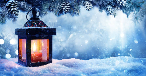 christmas lantern on snow with fir branch in evening scene - dicembre foto e immagini stock