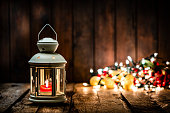 istock Christmas lantern on wooden table. Copy space 1270902502