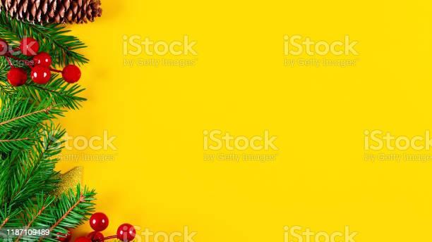 Christmas left border on vivid yellow background picture id1187109489?b=1&k=6&m=1187109489&s=612x612&h=lwhueoput j38pprvq1pcw8su 4imzp7u5dkufu9xlq=