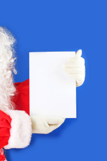 Christmas letter in Santa Claus hands. Close-up. stock photo