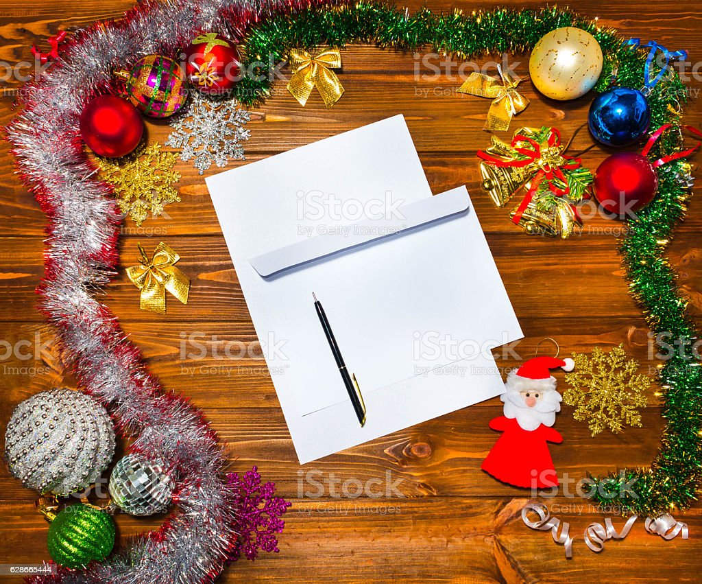 Christmas letter, list, congratulations on a wooden background with...