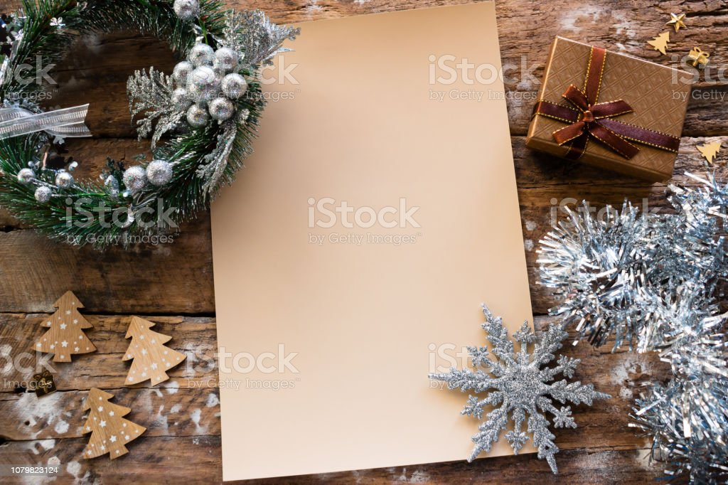 Christmas letter on wooden background with decorations