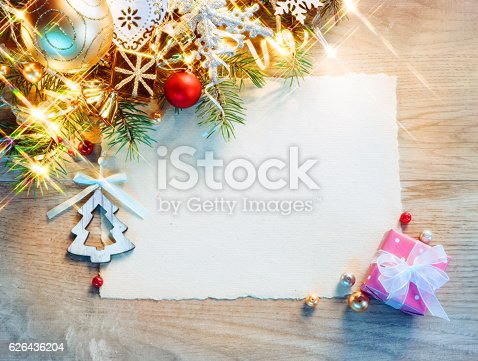 istock Christmas letter with decorated fir tree on wooden table 626436204