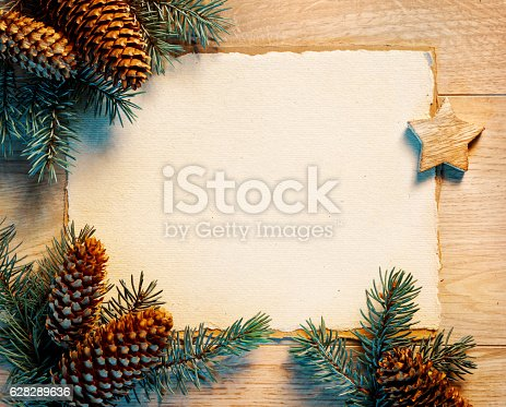 istock Christmas letter with fir branches,pinecones 628289636