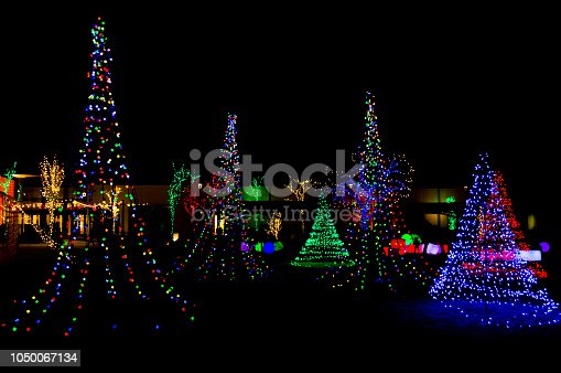 This is a Christmas light display in Orem, Utah.  Different colored trees surround the space and in the background are light up blocks and balls that kids can play with and push around.  I made the contrast high on this picture so the lights stand out against the black background of the night sky.