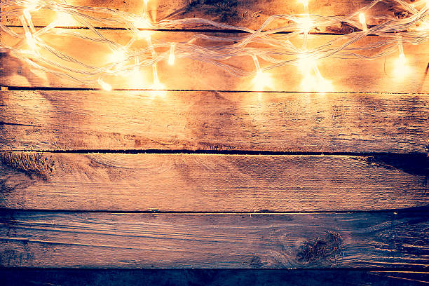 Christmas Light On Wooden Background With Space Stock Photo