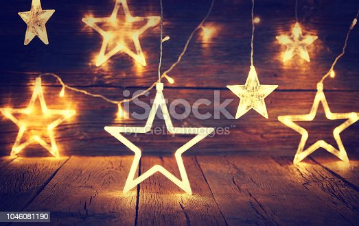 Christmas light stars vintage rustic wooden background decoration