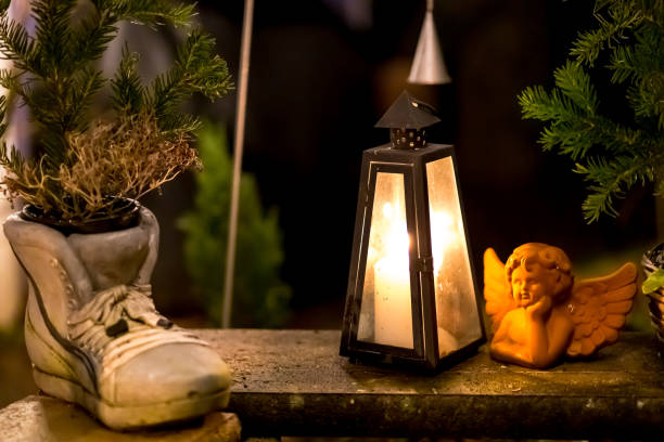 Christmas light with a stone angel and stone shoe at night stock photo