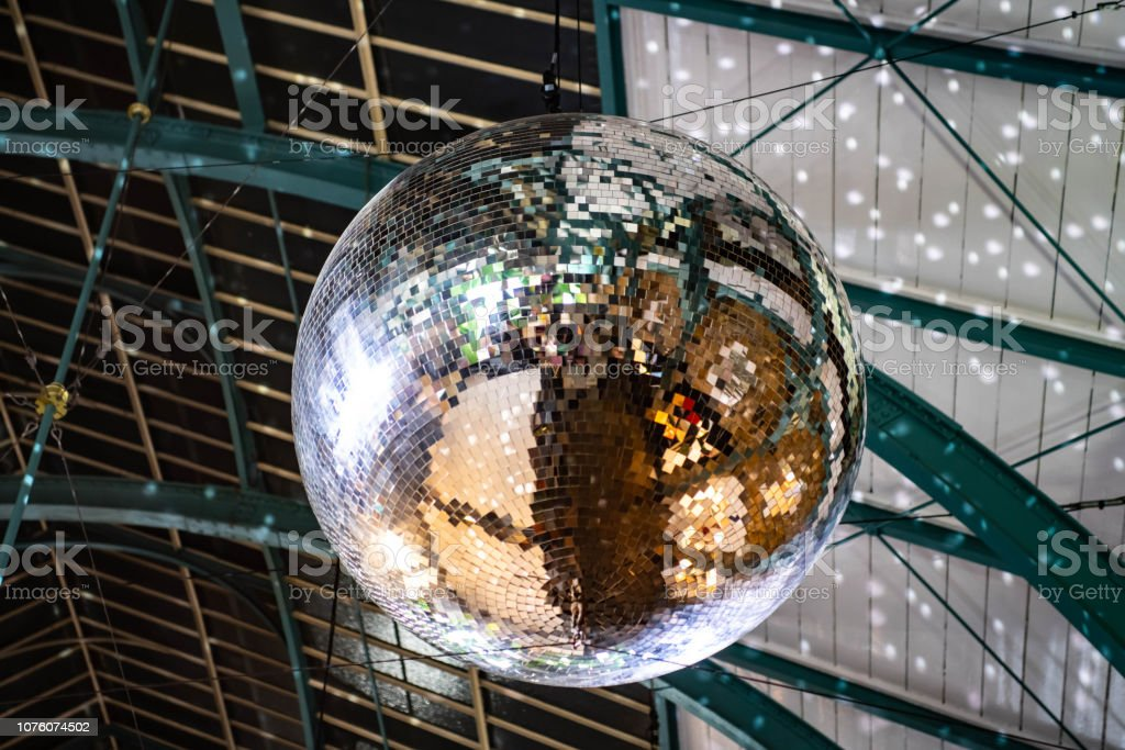 Christmas Lighting in Covent Garden market with a large glitter ball...