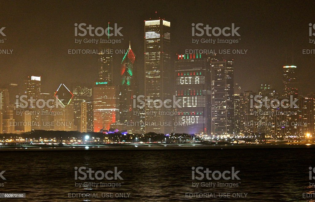 Christmas lighting of buildings, 'Get a Flu Shot' message, Chicago stock photo