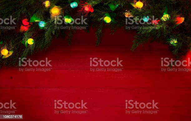 Christmas lights and pine tree on red wood background picture id1080374176?b=1&k=6&m=1080374176&s=612x612&h=onstzpow xuywds0oxbsqakf9awwlsx idx31nyonmc=
