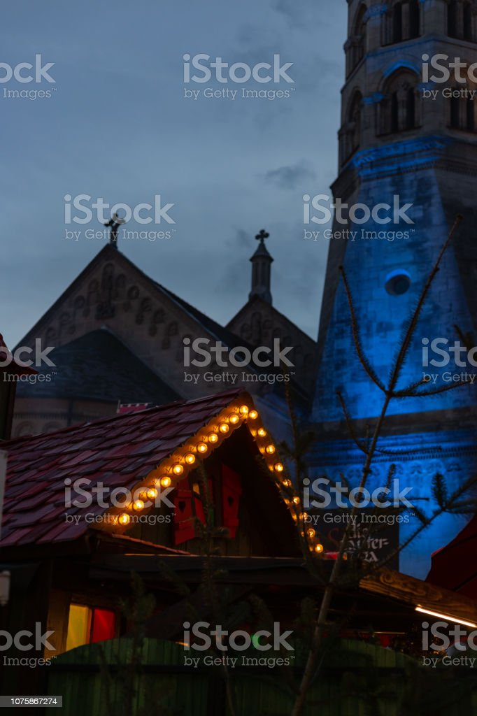 christmas lights at market place in advent december blue hour sky in...