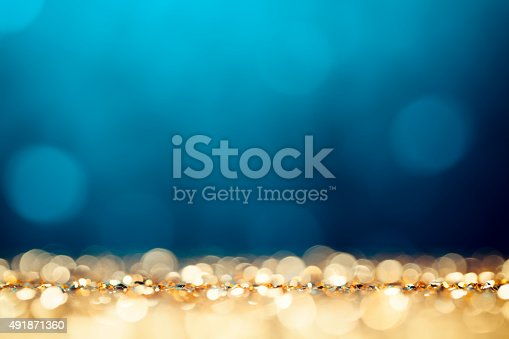 istock Christmas Lights Background - Bokeh Gold Blue Defocused 491871360