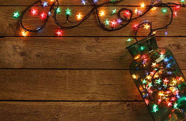 Christmas lights border on wood background picture id623298618?b=1&k=6&m=623298618&s=612x612&w=0&h=khkjvq 8gsfdqvm5okyyupjyoxcfblicat7bgytsdvq=