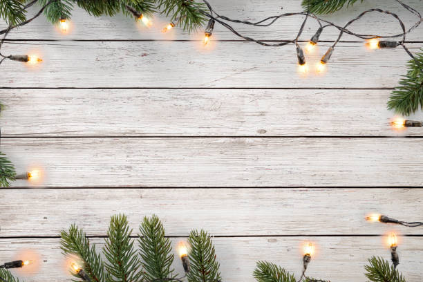 Christmas lights bulb and pine leaves decoration stock photo