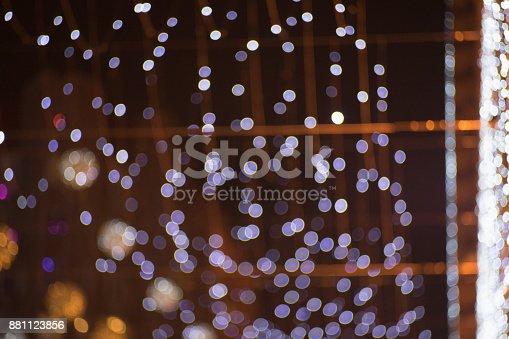 istock Christmas lights defocused background - Blue Bokeh 881123856
