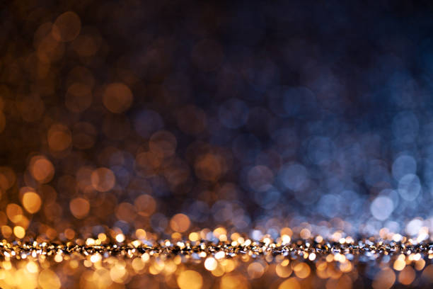 christmas lights defocused background - bokeh gold blue - holidays and celebrations stock pictures, royalty-free photos & images