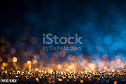 istock Christmas lights defocused background - Bokeh Gold Blue 613518332