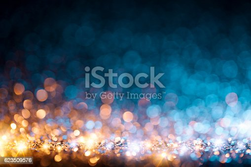 istock Christmas lights defocused background - Bokeh Gold Blue 623509576
