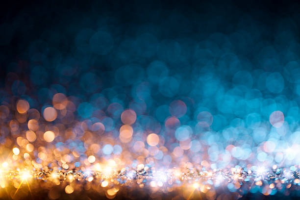 Christmas lights defocused background - Bokeh Gold Blue stock photo
