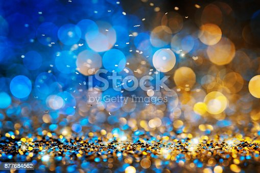 istock Christmas lights defocused background - Bokeh Gold Blue 877684562