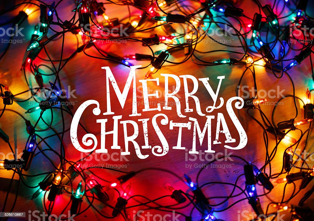 Christmas lights frame on wood background with Merry Christmas stock photo