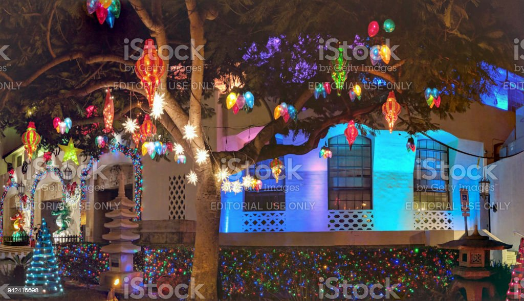 christmas lights hang from tree in front of honolulu hale royalty free stock photo