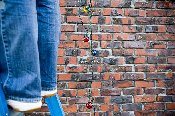 Christmas Lights Hanging from Ladder Outside, Copy Space stock photo
