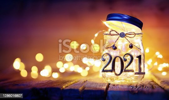 Happy New Year - Bokeh Lights And 2021 Metal Numbers In  Decorative Jar - Defocused Background
