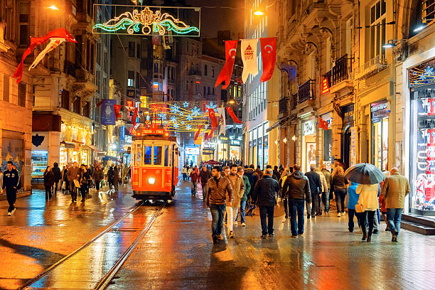 christmas lights, national flags and tramway in istanbul, turkey - istiklal avenue bildbanksfoton och bilder