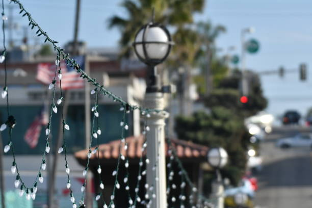 christmas lights on a sunny pier - steven harrie stock pictures, royalty-free photos & images