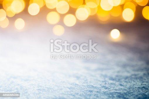 613518332 istock photo Christmas Lights on frozen blue - Background Bokeh 489688036