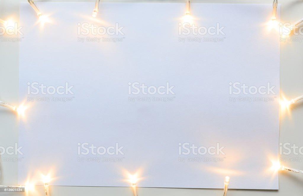 Christmas lights on gray table stock photo