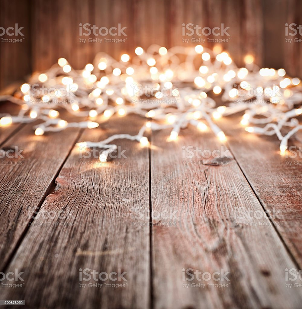 Christmas Lights On Old Rustic Wood Background Royalty Free Stock Photo