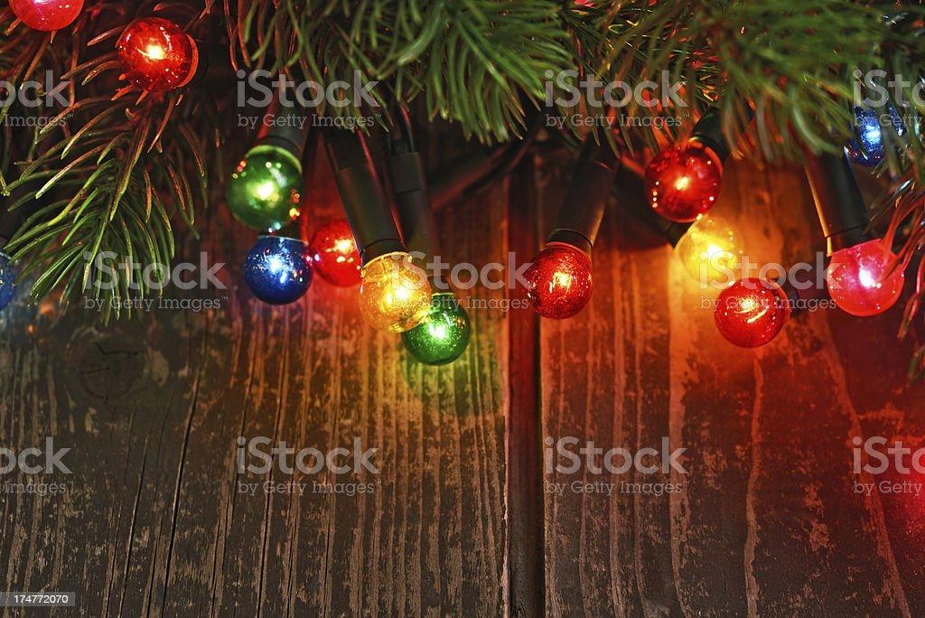 Christmas lights on rustic wood royalty-free stock photo