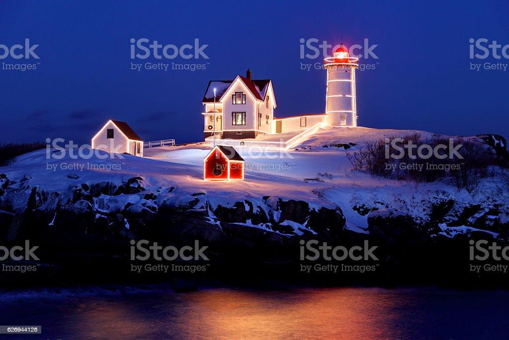Christmas Lights on the Nubble Light stock photo