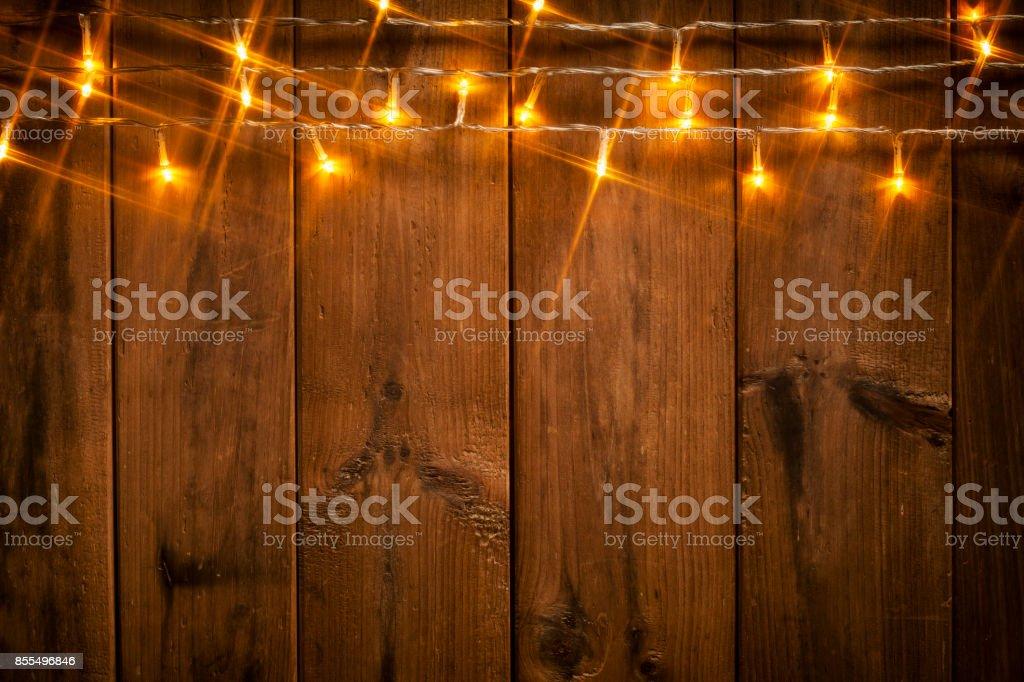 Lumières de Noël sur bois - célébration de fond - Photo