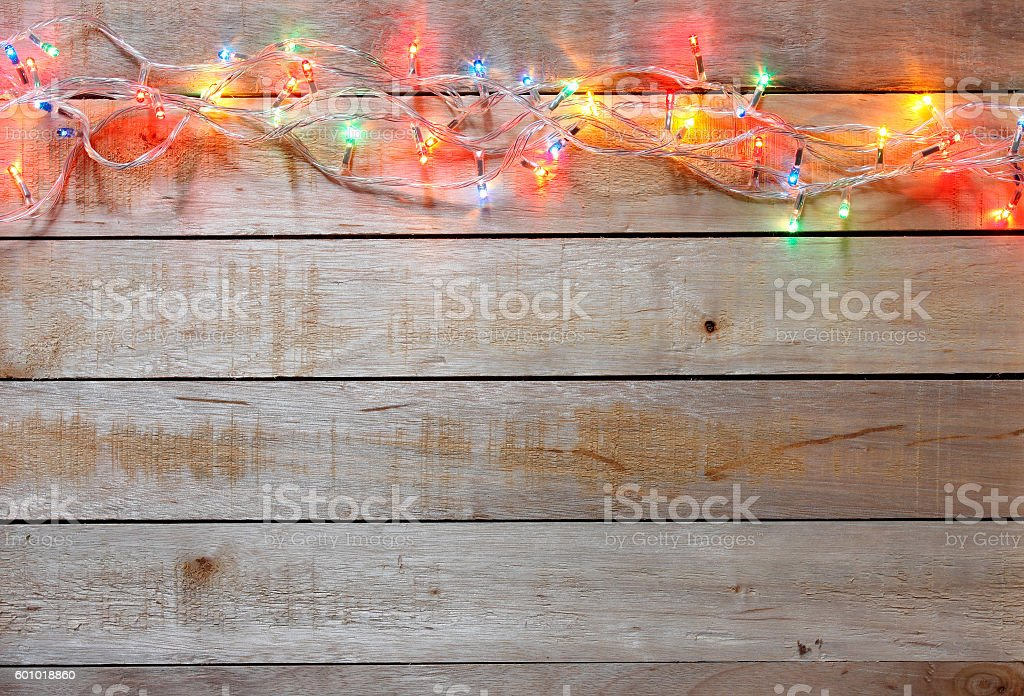 Christmas lights on wood stock photo