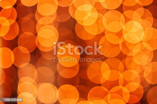 613518332 istock photo Christmas lights pattern defocused background 1066405406