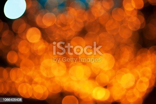 istock Christmas lights pattern defocused background 1066405408