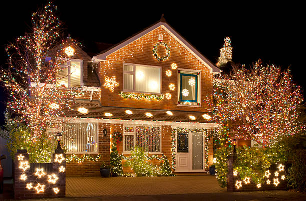 Christmas Lights Christmas Lights outside on a house and in the garden christmas decoration stock pictures, royalty-free photos & images