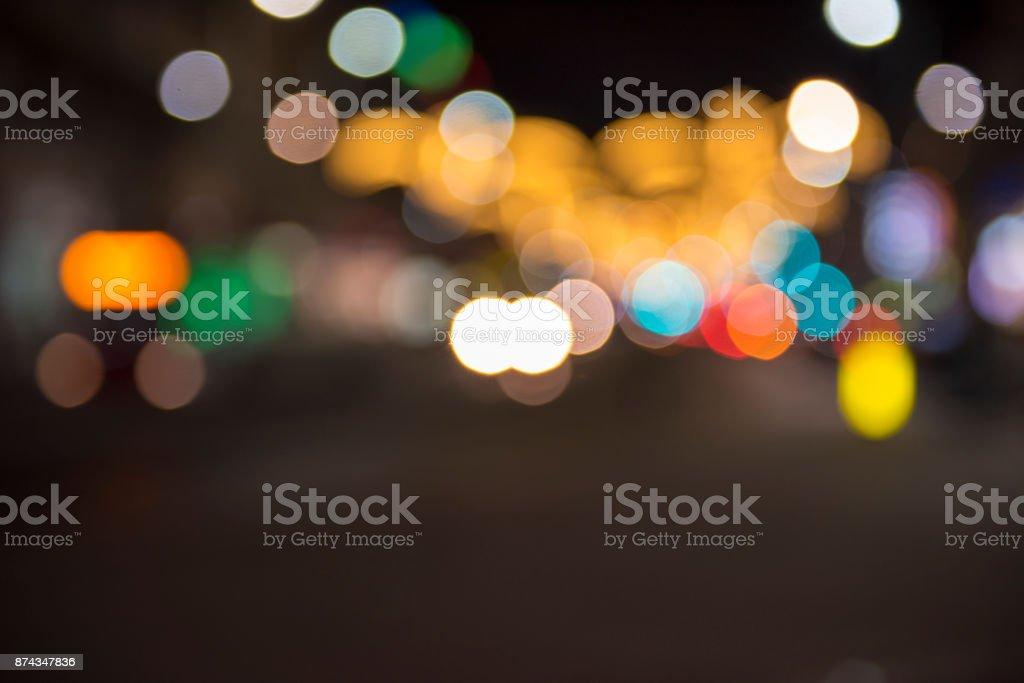 Christmas lights with blur bokeh. Night lights on street. Bokeh light abstract background. stock photo