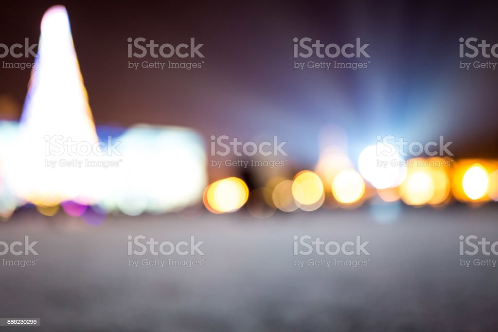 Christmas lights with blur bokeh. Night lights on street. Bokeh light abstract background stock photo