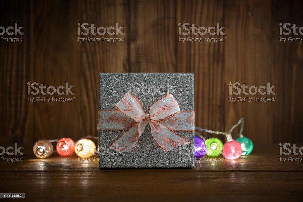 Christmas lights with silver gift box royalty-free stock photo